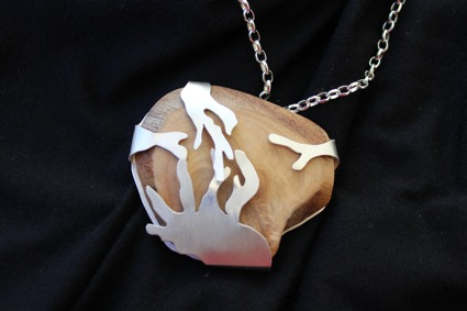 Encase. Pendant. Sterling silver setting with sandalwood.